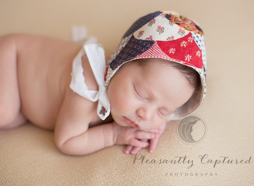 P i n newborn sleeping peacefully with custom made bonnet pleasantly captured photography jacksonville nc newborn photographer wilmington nc