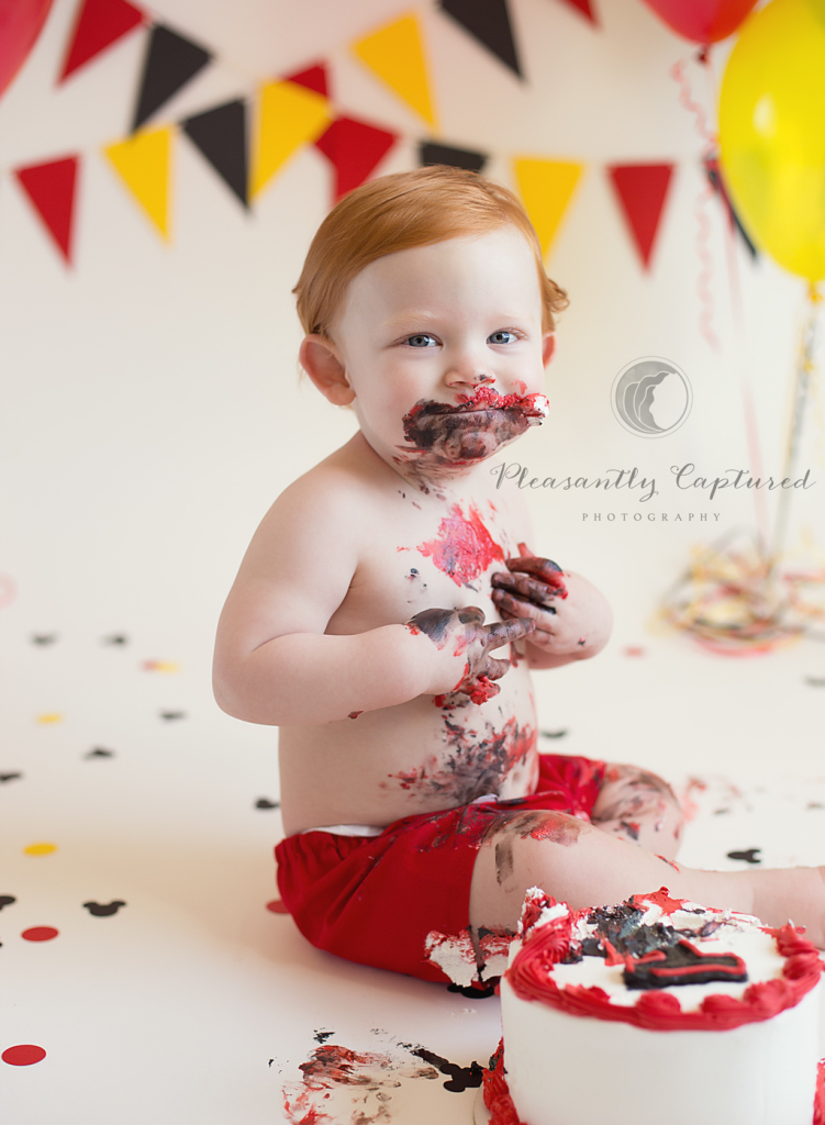 Baby H eats cake at his Mickey Mouse themed cake smash session | Pleasantly Captured Photography | Jacksonville NC Baby Photographer