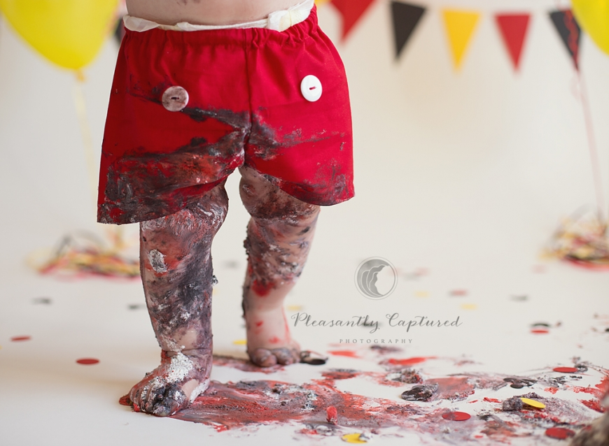 Baby boy makes a mess at his Mickey Mouse themed cake smash session | Pleasantly Captured Photography | Baby Photographer Jacksonville NC