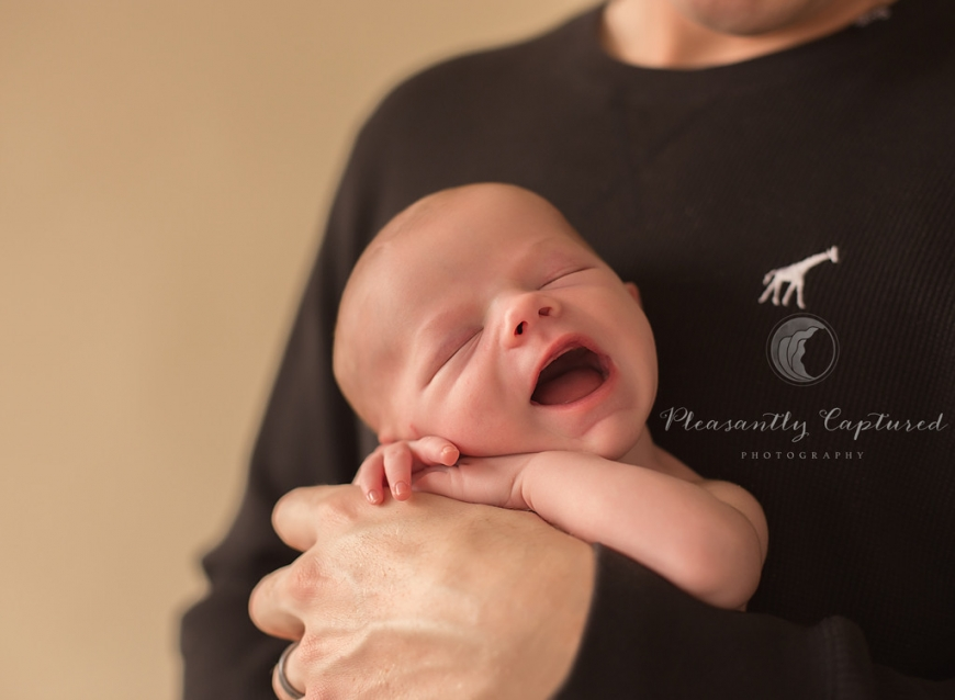 P i n smiling newborn boy being held by father baby l pleasantly captured photography jacksonville