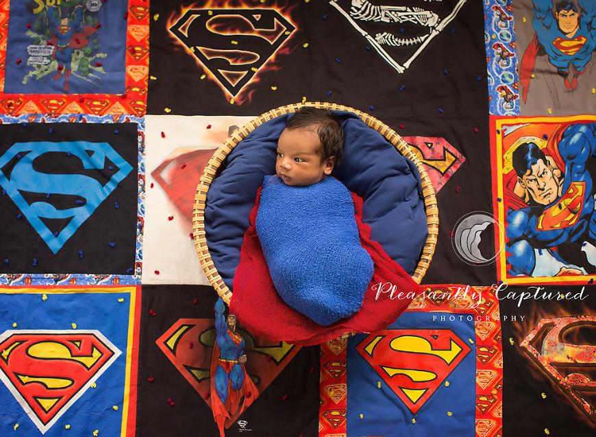 Newborn boy dressed in superman colors|Newborn Photographer Jacksonville-Wilmington NC