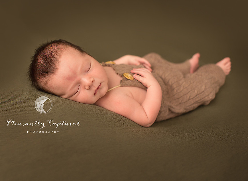 Newborn boy sleeps on back in romper - Pleasantly Captured Photography - Baby H makes 4| Jacksonville Newborn-Family Photography