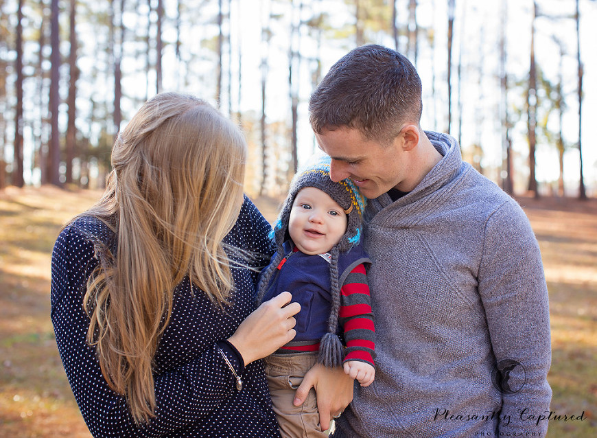 Little boy smiles as his mom and dad tickle him - Pleasantly Captured Photography - Camp Lejeune NC Photographer