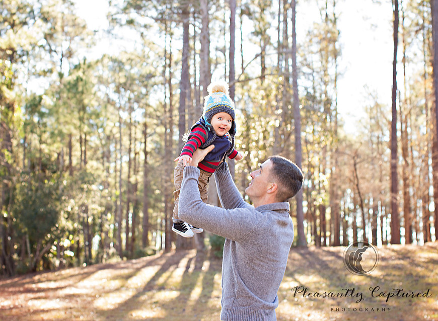 Little boy laughs while dad tosses him up in the air - Pleasantly Captured Photography - Camp Lejeune NC Photographer