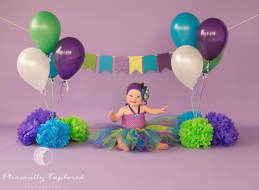 Pleasantly Captured Photography - Fun peacock themed cake smash - Jacksonville Baby Photographer
