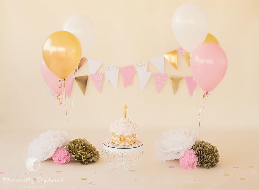 Beautiful pink, gold and white cake smash setup - Pleasantly Captured Photography - Cake Smash Photographer Jacksonville NC