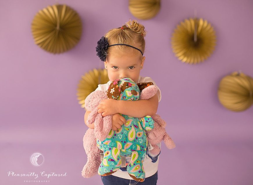 Little girl snuggles her stuffed animals - Pleasantly Captured Photography - Child Photographer Jacksonville NC
