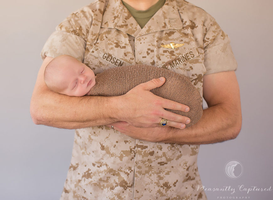 Marine in uniform holds his newborn son - Pleasantly Captured Photography - Newborn-baby photographer jacksonville nc