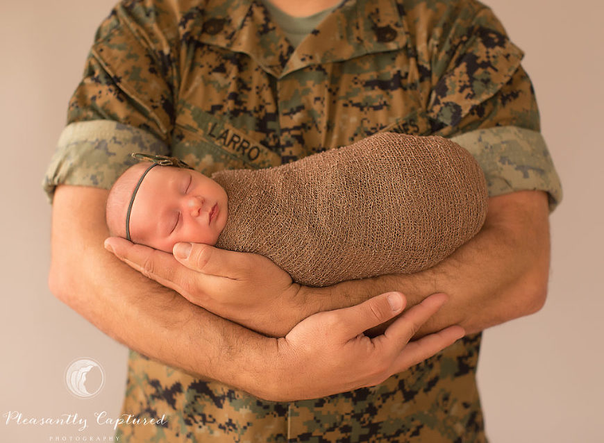 Marine father holding his newborn daughter - Pleasantly Captured Photography - Newborn Photography Jacksonville NC