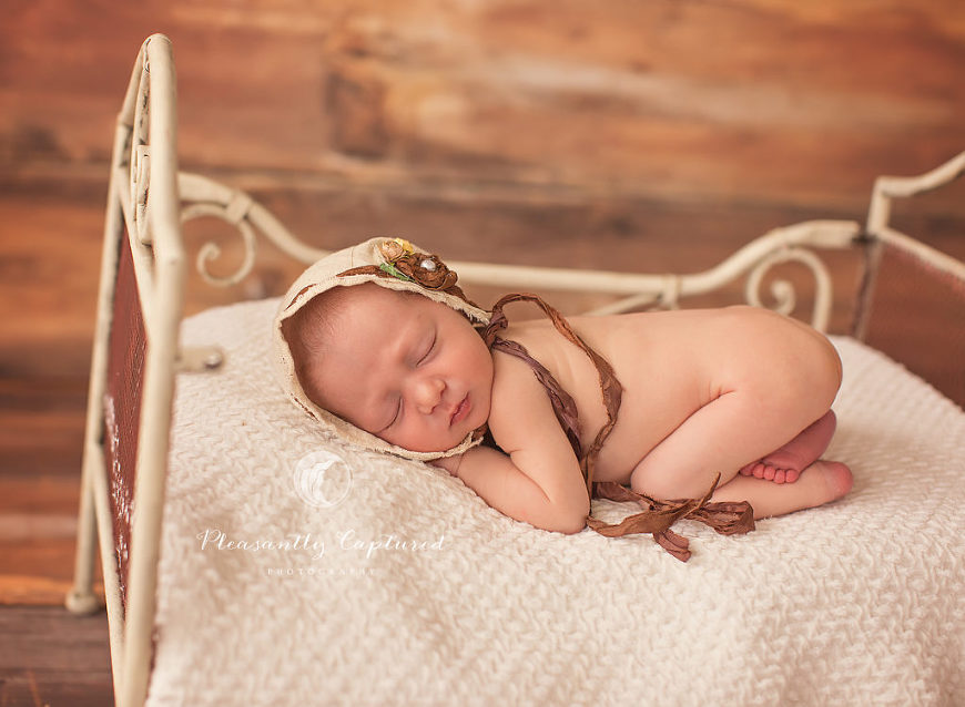 Newborn baby girl in rustic bonnet and bed - Pleasantly Captured Photography - Newborn Photography Jacksonville NC