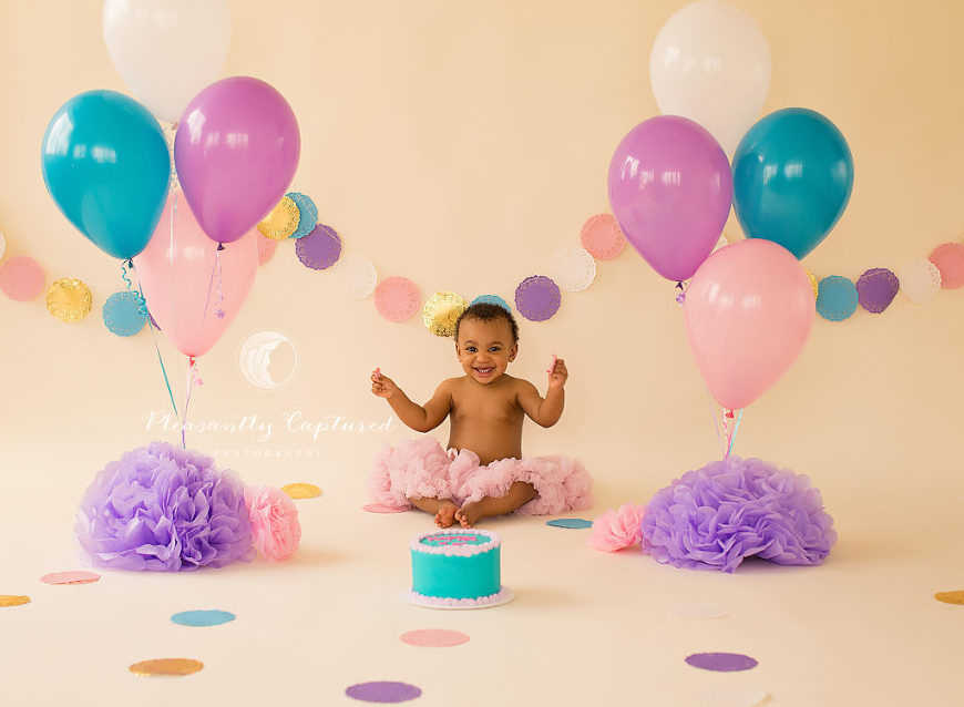 Baby girl is excited to see her birthday cake - Pleasantly Captured Photography - First Birthday Photography Jacksonville NC