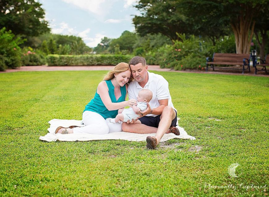 Family of 3 sitting in park - Pleasantly Captured Photography - Photographer Jacksonville NC