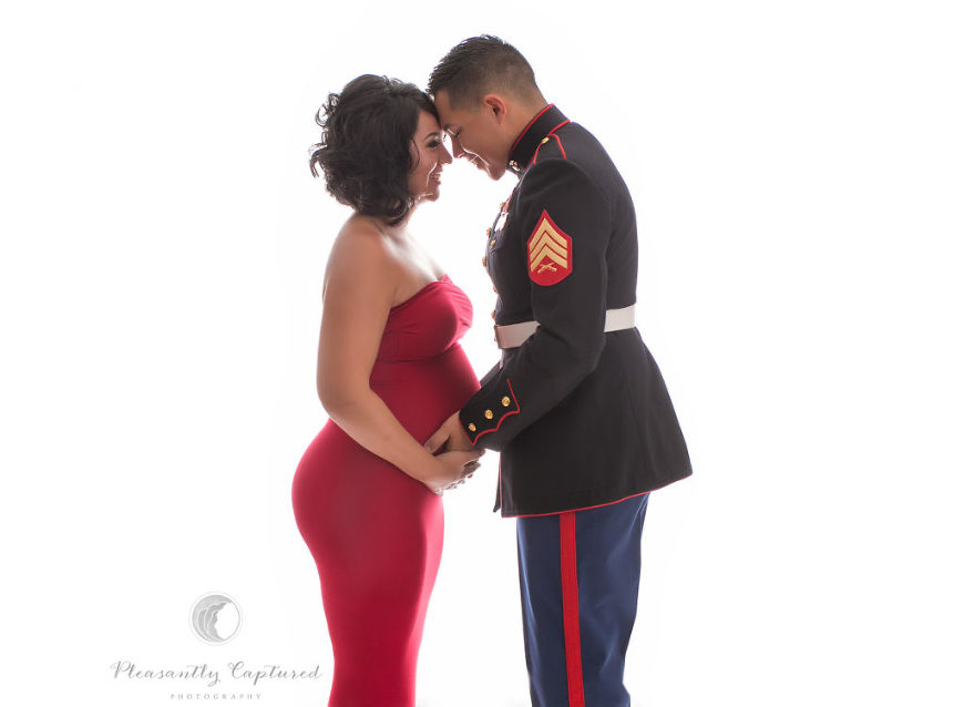 Pregnant mother in red dress and father in dress blues smile - Pleasantly Captured Photography - Jacksonville NC Pregnancy Photographer