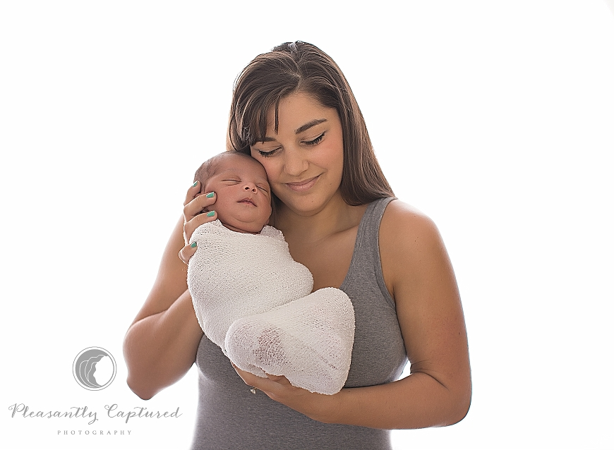 Beautiful new mother snuggles with her newborn son - Pleasantly Captured Photography - Newborn Photographer Jacksonville NC
